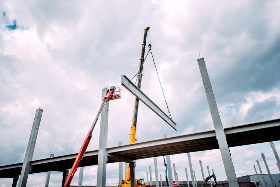 Crane lifting concrete frameworks, shutterings and heavy prefabricated concrete components